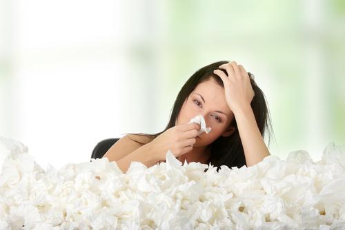 Woman surrounded by a lot of tissues