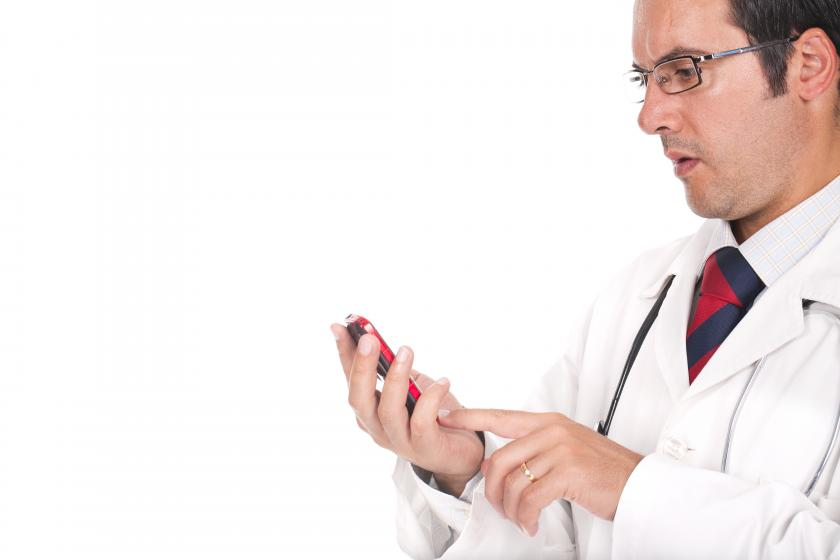 doctor using mobile phone