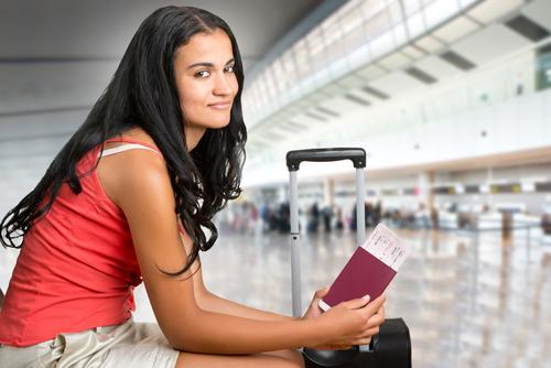 Woman at airport holding passport