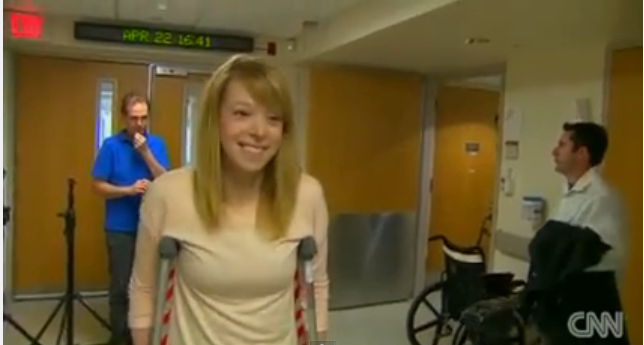 Adrianne Haslet-Davis walks with crutches in hospital