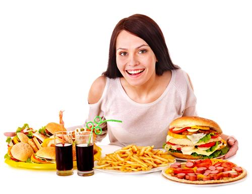 Woman eating fast food alone