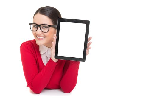 Woman with glasses holding tablet in hand