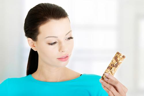 Woman looking at granola bar