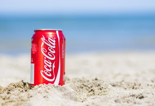 Coca-Cola can on sand