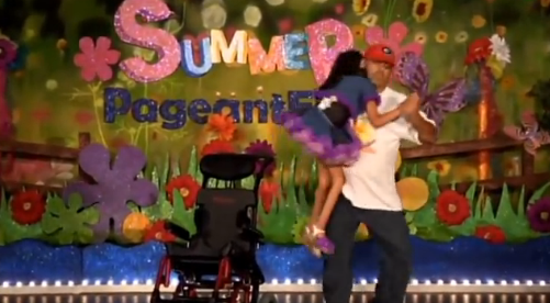 Father dancing with special needs daughter at beauty pageant