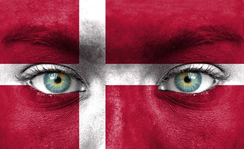 Woman's face painted with Denmark flag