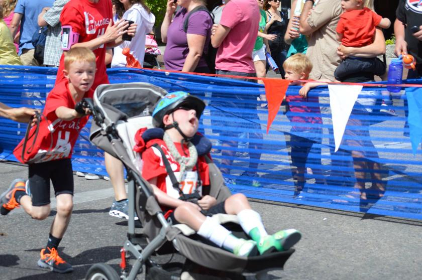 8-Year-Old Carries His Disabled Brother Through Triathlon [VIDEO]
