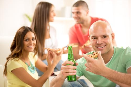 People eating, smiling, and drinking