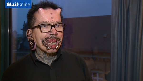 Rolf Buchholz talks about piercings and tattoos