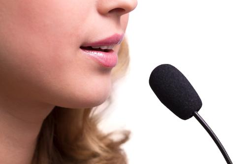 Lips of girl speaking into microphone