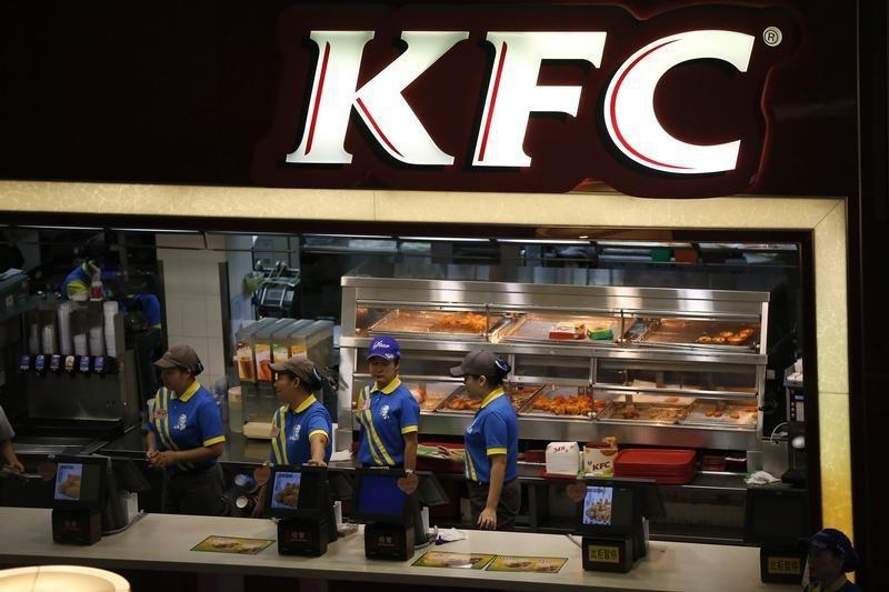 Comkfc Kitchen : Employees work at a KFC store in Shanghai, July 29, 2014. REUTERS/Aly ...