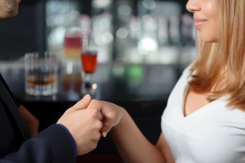 Close-up of a man and a young woman in a bar or nightclub