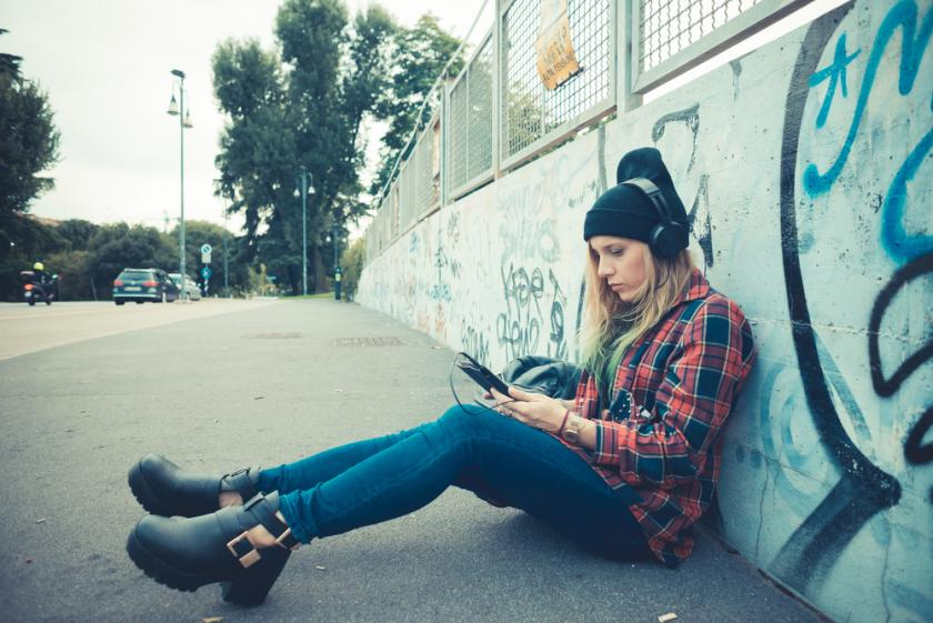 Woman listening to music on the street