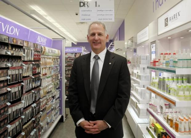 Greg Wasson, CEO of Walgreens, poses in a newly opened Duane Reade