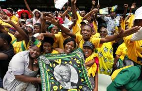 African National Congress (ANC) supporters hold a picture of former South African President Thabo Mbeki during the ANC's centenary celebration in Bloemfontein January 8, 2012.