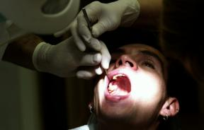Dentist with Male Patient