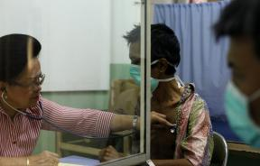 doctor checks tuberculosis patient in Indonesia