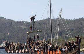 Vikings sail on a boat during the annual Viking festival in Spain