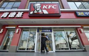 A man walks out from a KFC restaurant in Taiyuan, Shanxi province.