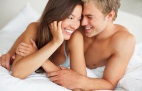 A man and woman in bed together.