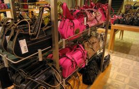 Leather handbags in store rack.
