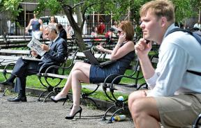 People using electronic devices outside