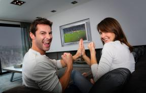 Couple watching sports together