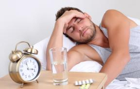 Man with headache in bed