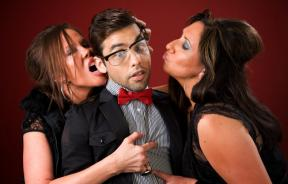 Two aggressive cougar women with shy young man