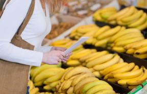 Woman buying bananas at the supermarket