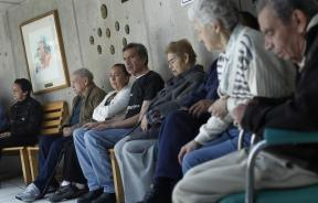 Alzheimer's patients wait to be seen by a healthcare professional.