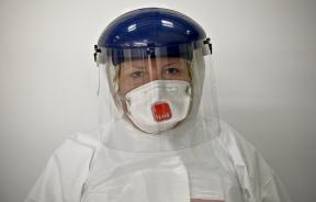 health care worker in safety suit