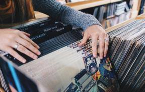 Woman looking at records