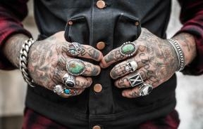 Man with tattoos on hands
